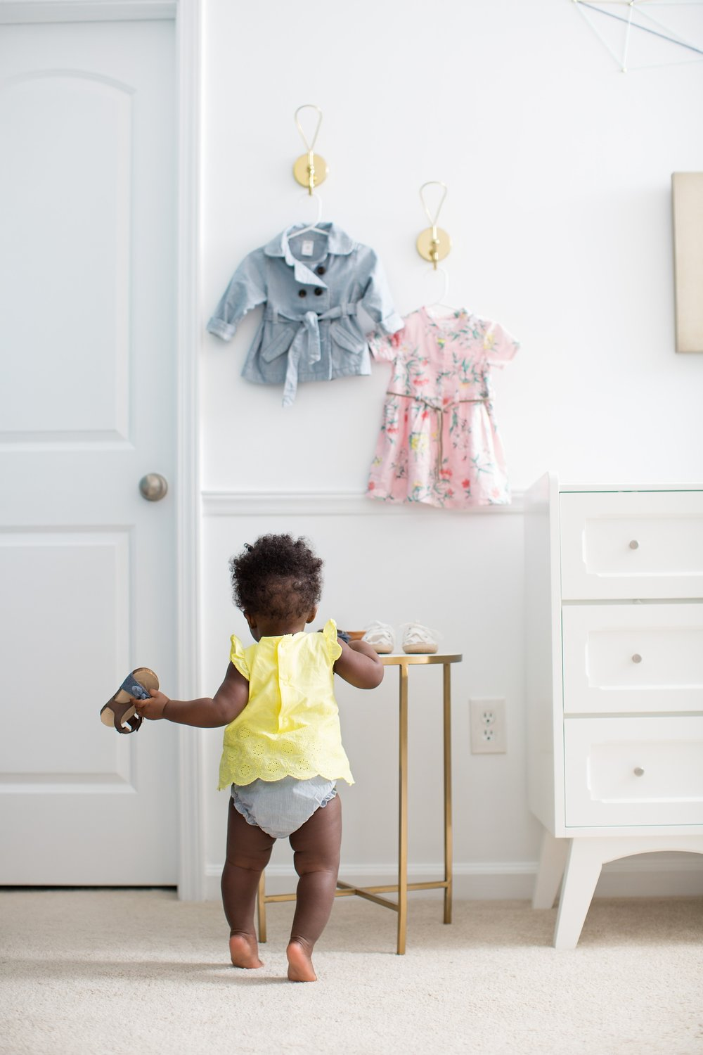 Baby in lemon and denim Carter's romper