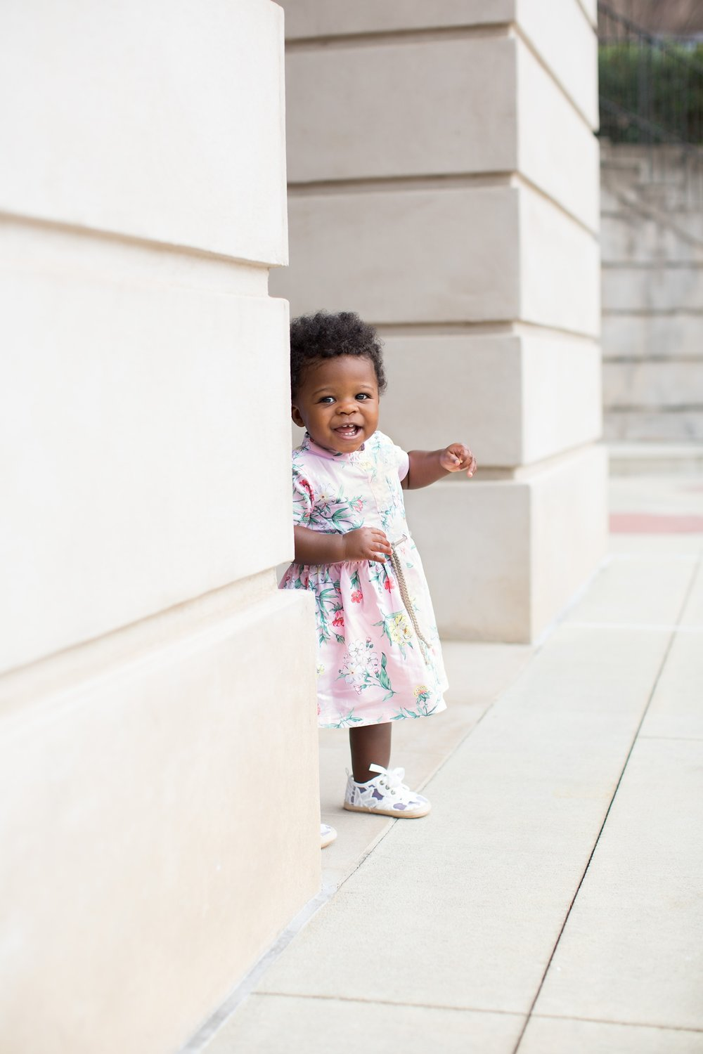 Baby girl in pink floral dress