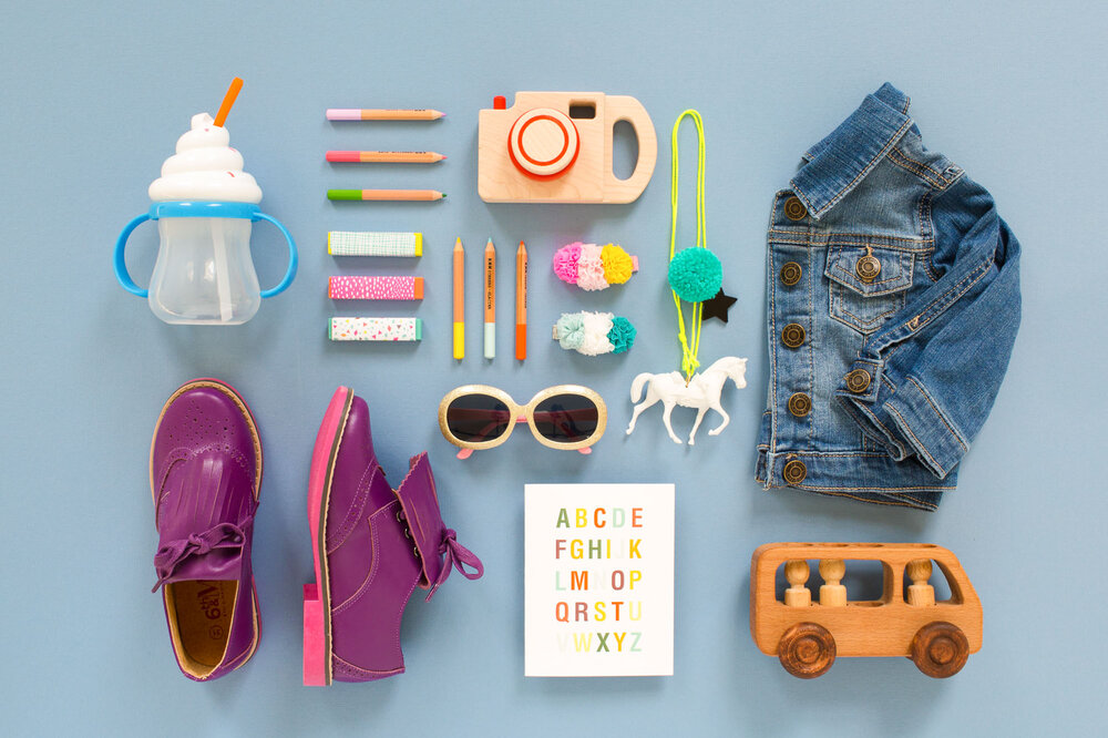 Colorful image of children's items in a knolling flat lay composition.
