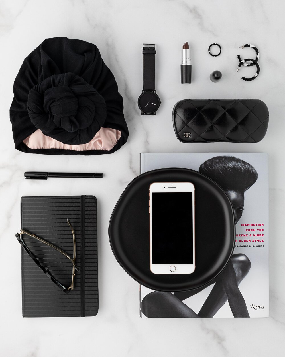 Black and white flat lay knolling image.