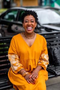 Headshot of Kimberly Murray in yellow dress